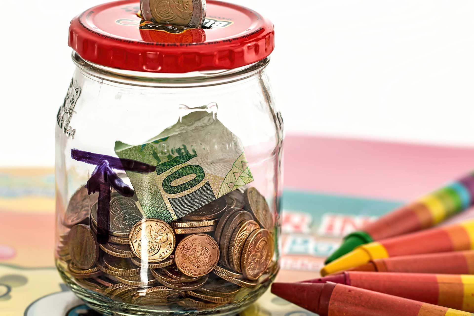 Savings jar with coins